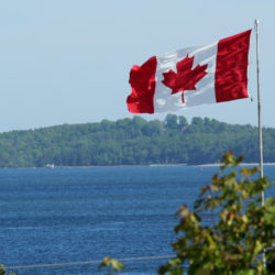 Canadian flag across the water - looks signifies opportunity to most Americans