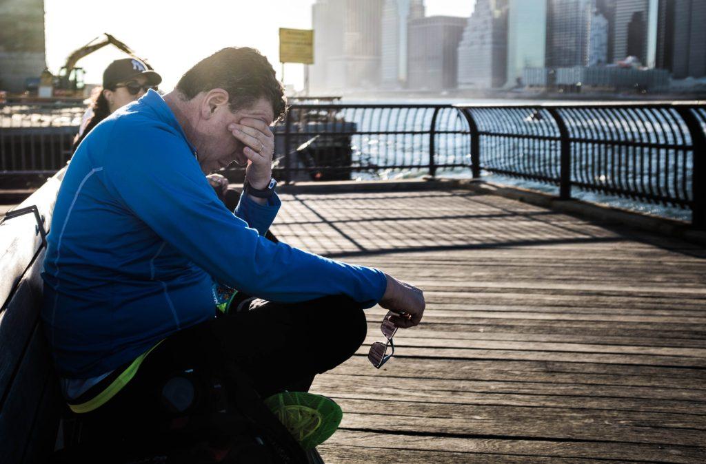 Man on dock in despair