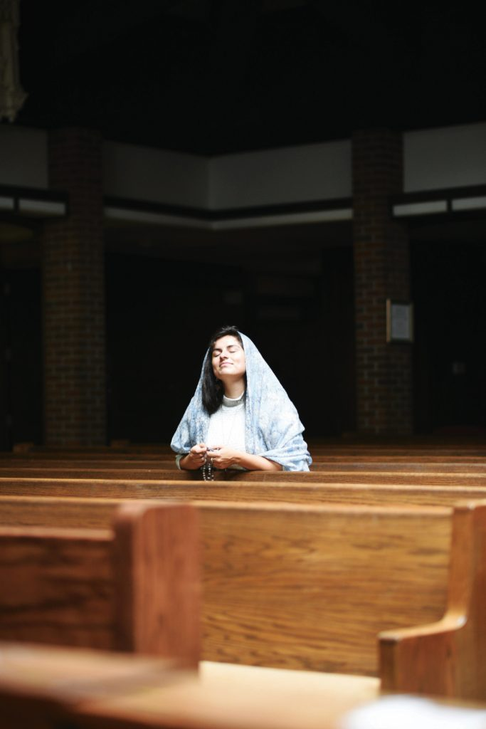 Child abuse in Catholic Church woman praying